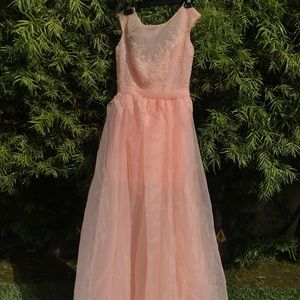 Long prom like dress. Peach in color. Never worn